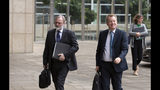United Kingdom's Brexit advisor David Frost, right, and British Ambassador to the EU Tim Barrow arrive at EU headquarters for a technical meeting on Brexit in Brussels, Wednesday, Sept. 11, 2019. (AP Photo/Virginia Mayo)