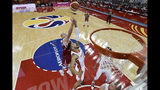 Willy Hernangomez Geuer of the Spain, center, fights for a ball against Poland, rear, during the Basketball World Cup Quarter-Finals between Spain and Poland in Shanghai on Tuesday, Sept. 10, 2019. (Wang Zhao/Photo