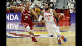Ricky Rubio of Spain controls the ball over Lukasz Koszarek of Poland during their quarterfinals match for the FIBA Basketball World Cup, at the Shanghai Oriental Sports Center in Shanghai, Tuesday, Sept. 10, 2019. (AP Photo/Andy Wong)