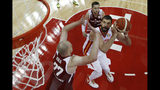 Marc Gasol of Spain prepares to put up a shot over Damian Kulig, left, during their quarterfinals match for the FIBA Basketball World Cup, at the Shanghai Oriental Sports Center in Shanghai, Tuesday, Sept. 10, 2019. (AP Photo/Andy Wong, Pool)
