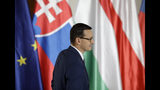 Prime Minister of Poland Mateusz Morawiecki arrives for the V4 summit at the Prague Castle, Czech Republic, Thursday, Sept. 12, 2019. (AP Photo/Petr David Josek)