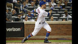 New York Mets' Todd Frazier watches his two-run home run during the first inning of the team's baseball game against the Arizona Diamondbacks, Wednesday, Sept. 11, 2019, in New York. (AP Photo/Kathy Willens)