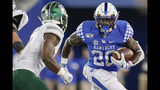 Kentucky running back Kavosiey Smoke (20) runs with the ball during the second half of an NCAA college football game against Eastern Michigan, Saturday, Sept. 7, 2019, in Lexington, Ky. (AP Photo/Bryan Woolston)