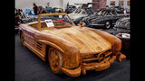 A Mercedes 300 SL Gullwing Roadster made of Teak wood is displayed at the IAA Auto Show in Frankfurt, Germany, Wednesday, Sept. 11, 2019. (AP Photo/Michael Probst)