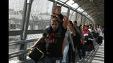 "FILE - In this April 29, 2019 file photo, Cuban migrants are escorted by Mexican immigration officials in Ciudad Juarez, Mexico, as they cross the Paso del Norte International bridge to be processed as asylum seekers on the U.S. side of the border. Mexican Foreign Secretary Marcelo Ebrard said Thursday, Sept. 12, 2019 that Mexico's government doesn't agree with an ""astonishing"" U.S. Supreme Court order that would block migrants from countries other than Mexico and Canada from applying for asylum at U.S. borders. (AP Photo/Christian Torres, File)"