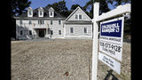 In this Sept. 3, 2019, photo a sign rests in front of a newly constructed home, in Westwood, Mass. On Thursday, Sept. 12, Freddie Mac reports on this week's average U.S. mortgage rates. (AP Photo/Steven Senne)