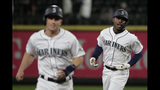 Seattle Mariners' Kyle Lewis, right, rounds the bases with Kyle Seager, left, after Lewis hit a three-run home run against the Cincinnati Reds during the seventh inning of a baseball game, Wednesday, Sept. 11, 2019, in Seattle. Lewis ended a no-hitter by Reds pitcher Sonny Gray. (AP Photo/Ted S. Warren)