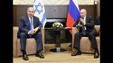 Russian President Vladimir Putin, right, and Israeli Prime Minister Benjamin Netanyahu talk during their meeting in Sochi, Russia, Thursday, Sept. 12, 2019. (Shamil Zhumatov/Pool Photo via AP)