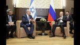 Russian President Vladimir Putin, center right, and Israeli Prime Minister Benjamin Netanyahu talk during their meeting in Sochi, Russia, Thursday, Sept. 12, 2019. (Shamil Zhumatov/Pool Photo via AP)
