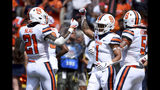 Syracuse wide receiver Sean Riley (1) celebrates with running back Moe Neal (21) after scoring a touchdown during the first half of an NCAA college football game against Maryland, Saturday, Sept. 7, 2019, in College Park, Md. (AP Photo/Will Newton)