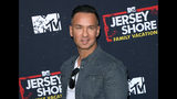 """FILE - In this March 29, 2018 file photo, Mike """"The Situation"""" Sorrentino arrives at the """"Jersey Shore Family Vacation"""" premiere in Los Angeles. Sorrentino has regained his freedom. The reality television star's publicist said he was released from prison in Otisville, New York, Thursday morning, Sept. 12, 2019, after serving about eight months for tax evasion. (Photo by Willy Sanjuan/Invision/AP, File)"""