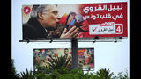 An electoral poster for jailed presidential candidate Nabil Karoui is pictured Tuesday Sept. 10, 2019 in Tunis. Tunisia's 26 presidential candidates launched their campaigns last week in a political climate marked by uncertainty, money laundering allegations and worries about violent extremism. (AP Photo/Hassene Dridi)