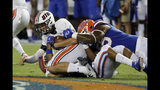 UT Martin quarterback John Bachus III, top left, is sacked by Florida linebacker Lacedrick Brunson, bottom, and defensive lineman Kyree Campbell, right, during the first half of an NCAA college football game Saturday, Sept. 7, 2019, in Gainesville, Fla. (AP Photo/John Raoux)