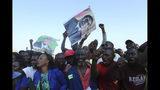 Supporters of Zimbabwe's former ruler, Robert Mugabe react upon the arrival of his remains at at RG Mugabe airport in Harare,Wednesday, Sept, 11, 2019.(AP Photo/Tsvangirayi Mukwazhi)