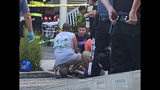 In this photo provided by James Macheda, first responders treat an injured person as they work the scene of a building structure damage in Wildwood, N.J., Saturday, Sept. 14, 2019. Multiple levels of decking attached to a building collapsed Saturday evening at the Jersey Shore, trapping people and injuring several, including children, officials and witnesses said. (James Macheda via AP)