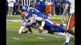 Kentucky defensive back Brandin Echols (26) brings down Florida quarterback Feleipe Franks (13) during the first half of an NCAA college football game in Lexington, Ky., Saturday, Sept. 14, 2019. (AP Photo/Timothy D. Easley)