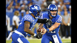 Kentucky quarterback Sawyer Smith (12) hands the ball off to running back Asim Rose (10) during the first half of an NCAA college football game in Lexington, Ky., Saturday, Sept. 14, 2019. (AP Photo/Timothy D. Easley)