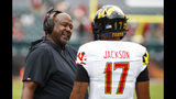 Maryland head coach Michael Locksley, left, talks things over with quarterback Josh Jackson (17) during the first half of an NCAA college football against Temple, Saturday, Sept. 14, 2019, in Philadelphia. (AP Photo/Chris Szagola)