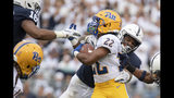 Penn State linebacker Micah Parsons (11) tackles Pittsburgh running back Vincent Davis (22) in the second quarter of an NCAA college football game in State College, Pa., on Saturday, Sept. 14, 2019. (AP Photo/Barry Reeger)