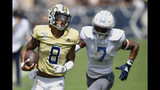 Georgia Tech quarterback Tobias Oliver (8) runs against Citadel defensive back Destin Mack (7) during the first half of an NCAA college football game, Saturday, Sept. 14, 2019, in Atlanta. (AP Photo/Mike Stewart)