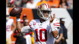 San Francisco 49ers quarterback Jimmy Garoppolo passes during the first half an NFL football game against the Cincinnati Bengals, Sunday, Sept. 15, 2019, in Cincinnati. (AP Photo/Frank Victores)