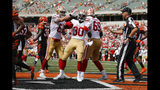 San Francisco 49ers running back Jeff Wilson Jr. (30) celebrates his touchdown during the second half an NFL football game against the Cincinnati Bengals, Sunday, Sept. 15, 2019, in Cincinnati. (AP Photo/Frank Victores)