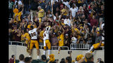 Arizona State players celebrate with fans following an NCAA college football game against Michigan State, Saturday, Sept. 14, 2019, in East Lansing, Mich. (AP Photo/Al Goldis)