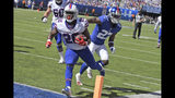 Buffalo Bills running back Devin Singletary (26), left, scores a touchdown during the first half of an NFL football game against the New York Giants, Sunday, Sept. 15, 2019, in East Rutherford, N.J. (AP Photo/Bill Kostroun)