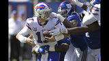 Buffalo Bills quarterback Josh Allen, left, is sacked during the first half of an NFL football game against the New York Giants, Sunday, Sept. 15, 2019, in East Rutherford, N.J. (AP Photo/Bill Kostroun)