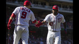 Washington Nationals Howie Kendrick (47) is congratulated by teammate Brian Dozier (9) after hitting a home run during the fifth inning of a baseball game against the Atlanta Braves in Washington, Sunday, Sept. 15, 2019. (AP Photo/Manuel Balce Ceneta)