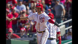 Washington Nationals' Trea Turner gestures at home plate as he watches teammate Anthony Rendon following him to score a run during the third inning of a baseball game against the Atlanta Braves in Washington, Sunday, Sept. 15, 2019. Turner and Rendon scored on Howie Kendrick's single during the third inning. (AP Photo/Manuel Balce Ceneta)