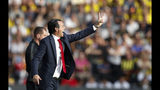 Arsenal's head coach Unai Emery gestures to his players from the sidelines during the English Premier League soccer match between Watford and Arsenal at the Vicarage Road stadium in Watford near London, Sunday, Sept. 15, 2019. The match ended in a 2-2 draw. (AP Photo/Alastair Grant)