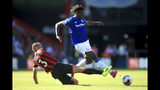 Bournemouth's Steve Cook, left, and Everton's Moise Kean battle for the ball during the English Premier League soccer match between Bournemouth and Everton at The Vitality Stadium, Bournemouth, England, Sunday, Sept. 15, 2019. (Adam Davy/PA via AP)