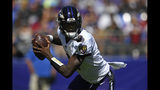 Baltimore Ravens quarterback Lamar Jackson looks for a receiver in the first half of an NFL football game against the Arizona Cardinals, Sunday, Sept. 15, 2019, in Baltimore. (AP Photo/Nick Wass)