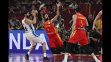Patricio Garino of Argentina is tackled by Ricky Rubio of Spain during their FIBA Basketball World Cup Final, at the Cadillac Arena in Beijing, Sunday, Sept. 15, 2019. (AP Photo/Ng Han Guan)