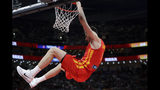 Juancho Hernangomez of Spain dunks the ball against Argentina during their FIBA Basketball World Cup Final, at the Cadillac Arena in Beijing, Sunday, Sept. 15, 2019. (AP Photo/Mark Schiefelbein)