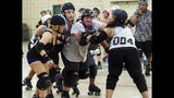 The scrum in action during a practice of the Panhandle United Roller Derby team at the Northwest Florida Fairgrounds, in Fort Walton Beach, Fla., Tuesday, August 20, 2019. (Michael Snyder/Northwest Florida Daily News via AP)