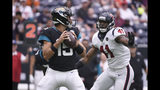Jacksonville Jaguars quarterback Gardner Minshew (15) is pressured by Houston Texans inside linebacker Zach Cunningham (41) during the first half of an NFL football game Sunday, Sept. 15, 2019, in Houston. (AP Photo/Eric Christian Smith)