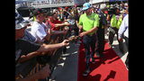 Kyle Busch gives autographs to fans before a NASCAR Cup Series auto race at Las Vegas Motor Speedway, Sunday, Sept. 15, 2019. (AP Photo/Chase Stevens)