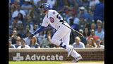 Kris Bryant, de los Cachorros de Chicago, conecta un cuadrangular de tres carreras en el primer inning del duelo ante los Piratas de Pittsburgh, el domingo 15 de septiembre de 2019, en Chicago. (AP Foto/Paul Beaty)