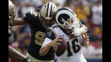 Los Angeles Rams quarterback Jared Goff, right, is sacked by New Orleans Saints defensive end Marcus Davenport during the first half of an NFL football game Sunday, Sept. 15, 2019, in Los Angeles. (AP Photo/Marcio Jose Sanchez)