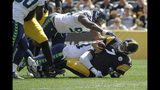 Pittsburgh Steelers quarterback Ben Roethlisberger (7) is sacked by Seattle Seahawks defensive end Rasheem Green (98) and Jadeveon Clowney in the first half of an NFL football game, Sunday, Sept. 15, 2019, in Pittsburgh. (AP Photo/Gene J. Puskar)