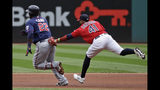 Cleveland Indians' Carlos Santana (41) tags out Minnesota Twins' Miguel Sano (22) in the first inning in a baseball game, Sunday, Sept. 15, 2019, in Cleveland. (AP Photo/Tony Dejak)