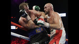 Tyson Fury, right, of England, punches Otto Wallin, of Sweden, during their heavyweight boxing match Saturday, Sept. 14, 2019, in Las Vegas. (AP Photo/Isaac Brekken)