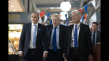 Britain's Prime Minister Boris Johnson, center, walks with Northern Powerhouse minister Jake Berry, left, and Damian Allen, Chief Executive Officer at Doncaster Council during a visit to Doncaster Market, in Doncaster, Northern England, Friday Sept. 13, 2019. Johnson will meet with European Commission president Jean-Claude Juncker for Brexit talks Monday in Luxembourg. The Brexit negotiations have produced few signs of progress as the Oct. 31 deadline for Britain's departure from the European Union bloc nears. ( AP Photo/Jon Super)
