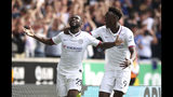 Chelsea's Fikayo Tomori, left, celebrates scoring his side's first goal of the game with teammate Tammy Abraham during their English Premier League soccer match against Wolverhampton Wanderers at Molineux, Wolverhampton, England, Saturday, Sept. 14, 2019. (Nick Potts/PA via AP)