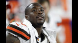 FILE - In this Aug. 8, 2019, file photo, Cleveland Browns defensive end Chris Smith (50) sits on the sideline during the first half of an NFL preseason football game against the Washington Redskins in Cleveland. Petara Cordero, the girlfriend of Smith has been killed in an accident early Wednesday, Sept. 11, 2019. The team said Cordero, 26, died when she was struck by an oncoming car on I-90 West at around 2 a.m. after she and Smith had pulled to the side of the road when the car he was driving had a tire malfunction and spun out. (AP Photo/Ron Schwane, File)