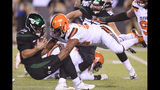 Cleveland Browns' Myles Garrett (95) sacks New York Jets' Trevor Siemian (19) during the first half of an NFL football game Monday, Sept. 16, 2019, in East Rutherford, N.J. (AP Photo/Bill Kostroun)