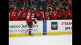 New Jersey Devils center Jack Hughes (86) celebrates with teammates after scoring a goal against the Boston Bruins during the second period of an NHL preseason hockey game, Monday, Sept. 16, 2019, in Newark, N.J. (AP Photo/Noah K. Murray)