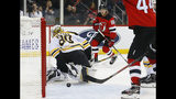 New Jersey Devils center Jack Hughes (86) scores a goal against Boston Bruins goaltender Kyle Keyser (85) during the second period of an NHL preseason hockey game Monday, Sept. 16, 2019, in Newark,N.J. (AP Photo/Noah K. Murray)